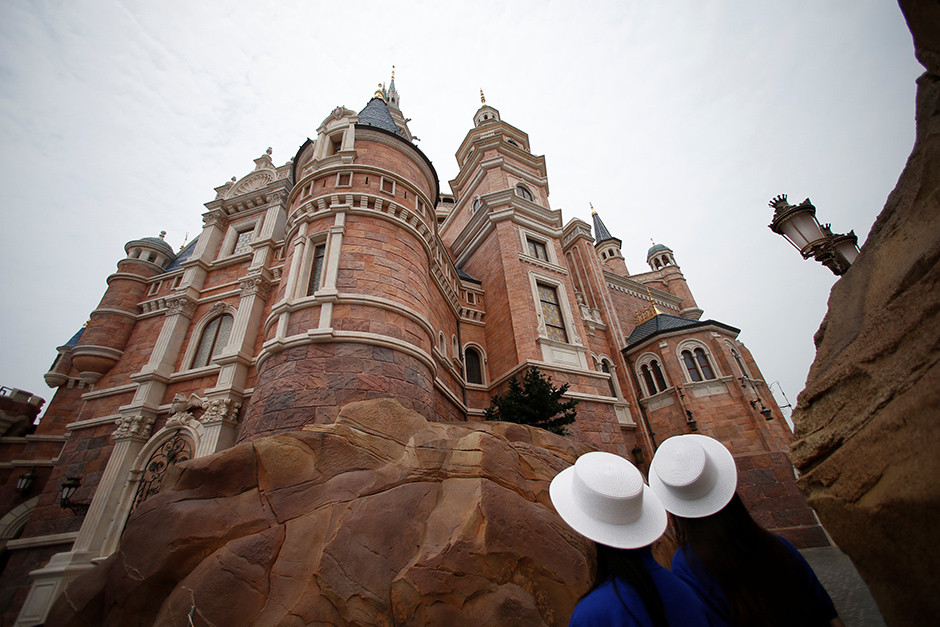 Staff stand at Shanghai Disney Resort during a three-day Grand Opening events in Shanghai