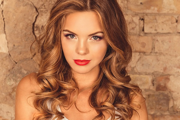 Cute girl with curling hair and red lips